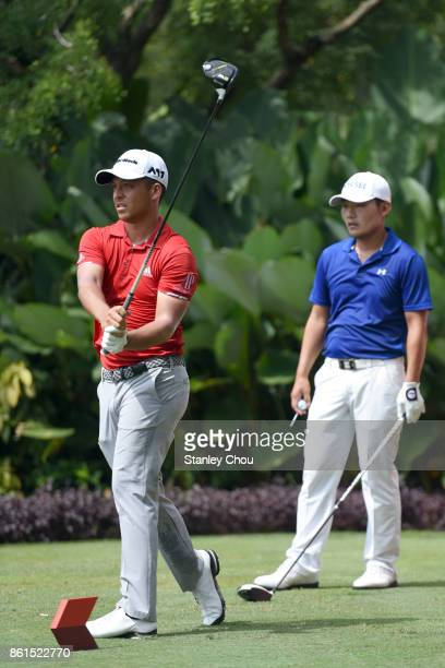 Xander Schauffele of the United States in action on the 5th hole wile Sung Kang of South Koea looks on during the final round of the 2017 CIMB...