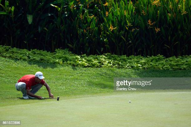 Xander Schauffele of the United States lines for a putt on the 4th hoe during the final round of the 2017 CIMB Classic at TPC Kuala Lumpur on October...