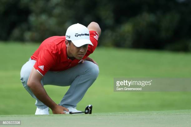 Xander Schauffele of the United States lines up a putt during the third round of the TOUR Championship at East Lake Golf Club on September 23 2017 in...