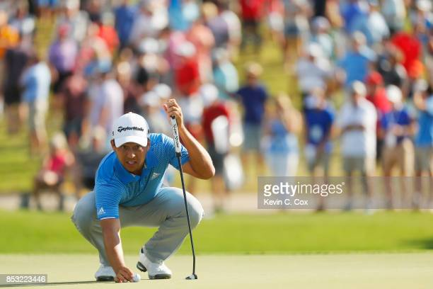 Xander Schauffele of the United States lines up a putt on the 15th green during the final round of the TOUR Championship at East Lake Golf Club on...