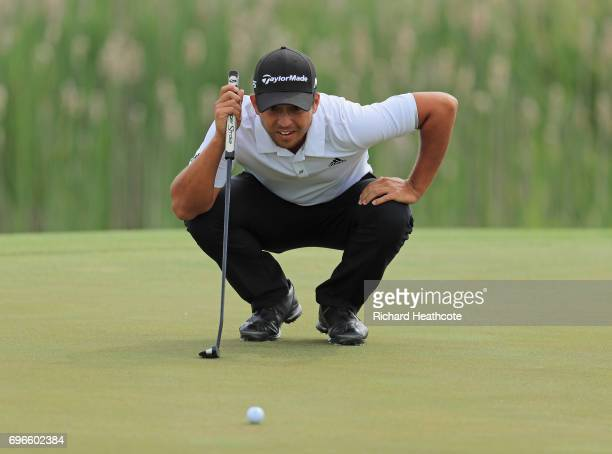 Xander Schauffele of the United States lines up a putt on the first green during the second round of the 2017 US Open at Erin Hills on June 16 2017...