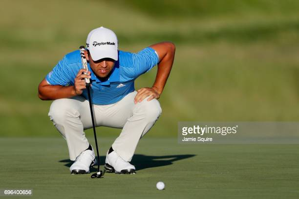 Xander Schauffele of the United States lines up a putt on the seventh green during the first round of the 2017 US Open at Erin Hills on June 15 2017...