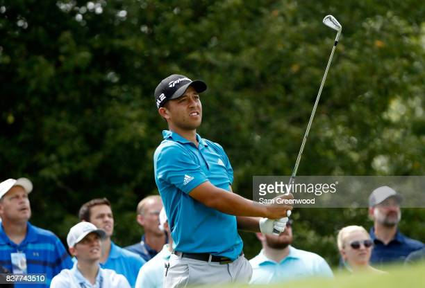 Xander Schauffele of the United States plays his shot during a practice round prior to the 2017 PGA Championship at Quail Hollow Club on August 8...