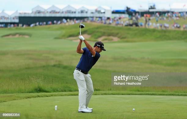 Xander Schauffele of the United States plays his shot from the first tee during the third round of the 2017 US Open at Erin Hills on June 17 2017 in...
