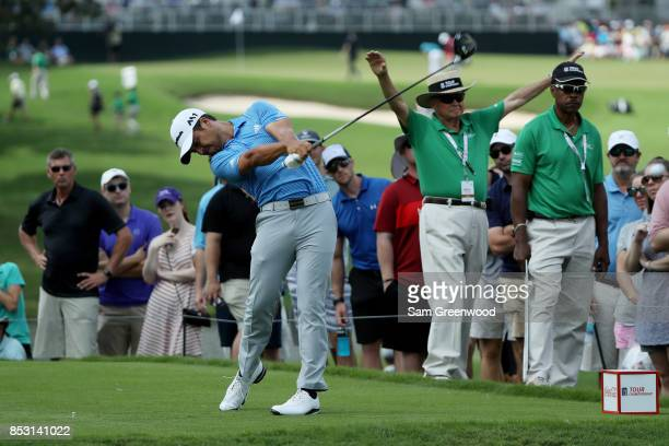 Xander Schauffele of the United States plays his shot from the fourth tee during the final round of the TOUR Championship at East Lake Golf Club on...