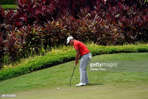 Xander Schauffele of the United States putts on the 16th hole during the final round of the 2017 CIMB Classic at TPC Kuala Lumpur on October 15 2017...