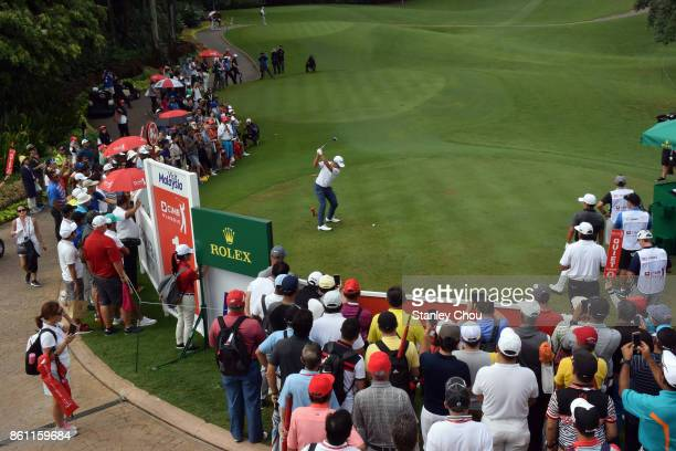 Xander Schauffele of the United States tees off on the 1st hole during round three of the 2017 CIMB Classic at TPC Kuala Lumpur on October 14 2017 in...