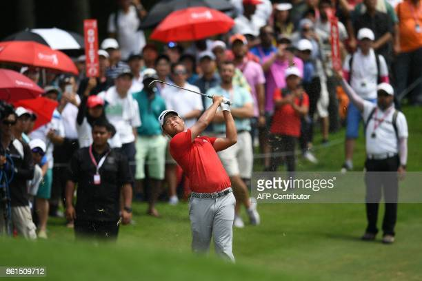 Xander Schauffele of the US plays a shot on the 16th fairway during the final round of the 2017 CIMB Classic golf tournament in Kuala Lumpur on...