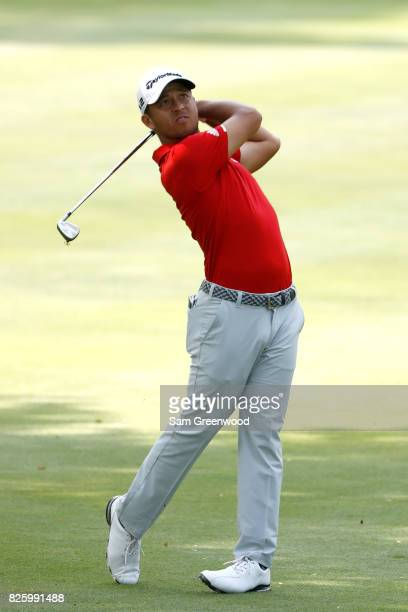 Xander Schauffele plays a shot on the 13th hole during the first round of the World Golf Championships Bridgestone Invitational at Firestone Country...