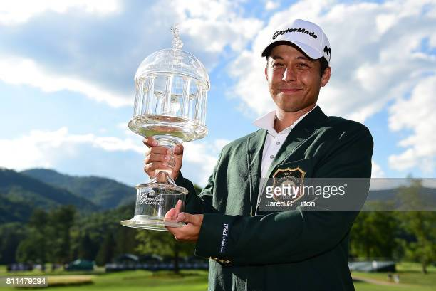 Xander Schauffele poses with the trophy after the final round of The Greenbrier Classic held at the Old White TPC on July 9 2017 in White Sulphur...