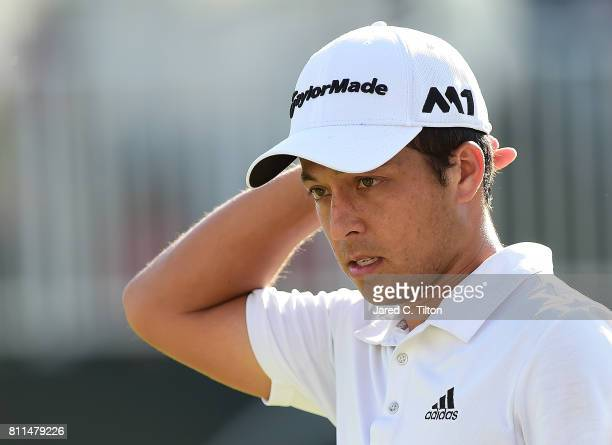 Xander Schauffele reacts after his birdie putt on the 18th green to take the outright lead during the final round of The Greenbrier Classic held at...