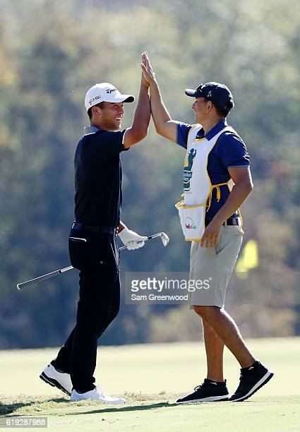 Xander Schauffele reacts after holing in on the second hole during the Final Round of the Sanderson Farms Championship at the Country Club of Jackson...