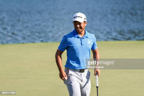 Xander Schauffele smiles after making a par putt on the 15th hole green during the final round of the TOUR Championship the last event of the...