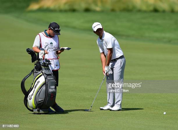 Xander Schauffele talks to his caddie on the 11th hole during the final round of The Greenbrier Classic held at the Old White TPC on July 9 2017 in...