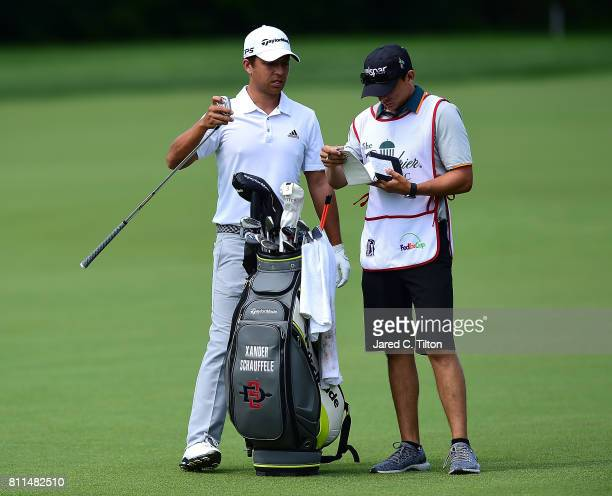 Xander Schauffele talks to his caddie on the 12th hole during the final round of The Greenbrier Classic held at the Old White TPC on July 9 2017 in...
