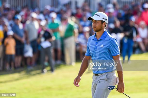 Xander Schauffele walks to the 18th hole green during the final round of the TOUR Championship the last event of the FedExCup Playoffs at East Lake...