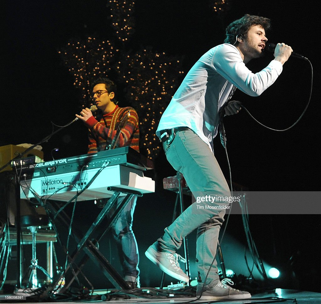 Xander Singh (L) and Michael Angelakos of Passion Pit perform during KROQ's Almost Acoustic Christmas Day Two at Gibson Amphitheatre on December 9, 2012 in Universal City, California.