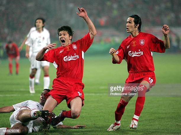 Xavi Alonso and Luis Garcia of Liverpool celebrate their side's third goal during the UEFA Champions League final between Liverpool and AC Milan on...
