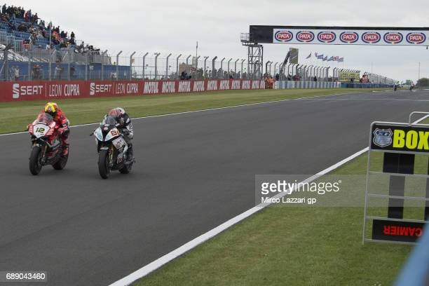 Xavi Fores of Spain and Barni Racing Team leads Jordi Torres of Spain and Althea BMW Racing Team during the Race 1 during the FIM Superbike World...