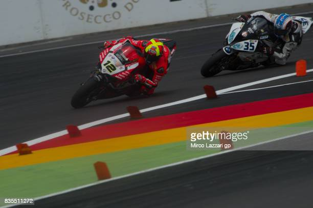 Xavi Fores of Spain and Barni Racing Team leads Raffaele De Rosa of Italy and Althea BMW Racing Team during the Superbike race 1 during the FIM...