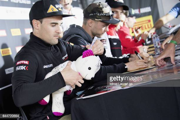 Xavi Fores of Spain and Barni Racing Team signs a small bear for a fan during the Autograph Session in paddock show during practice ahead of round...