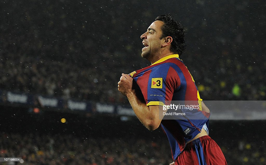 <a gi-track='captionPersonalityLinkClicked' href=/galleries/search?phrase=Xavi+Hernandez+-+Soccer+Player&family=editorial&specificpeople=2834438 ng-click='$event.stopPropagation()'>Xavi Hernandez</a> of Barcelna celebrates after scoring the first goal during the La Liga match between Barcelona and Real Madrid at the Camp Nou Stadium on November 29, 2010 in Barcelona, Spain. Barcelona won the match 5-0.