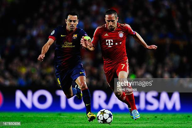Xavi Hernandez of Barcelona and Franck Ribery of Munich challenge for the ball during the UEFA Champions League semi final second leg match between...