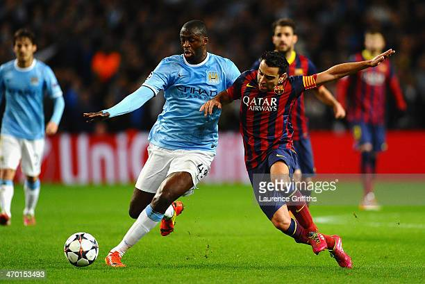 Xavi Hernandez of Barcelona battles with Yaya Toure of Manchester City during the UEFA Champions League Round of 16 first leg match between...