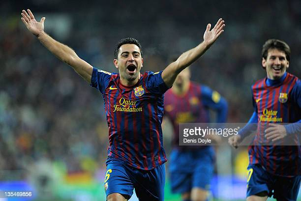 Xavi Hernandez of Barcelona celebrate after Barcelona scoring Barcelona's 2nd goal during the La Liga match between Real Madrid and Barcelona at...