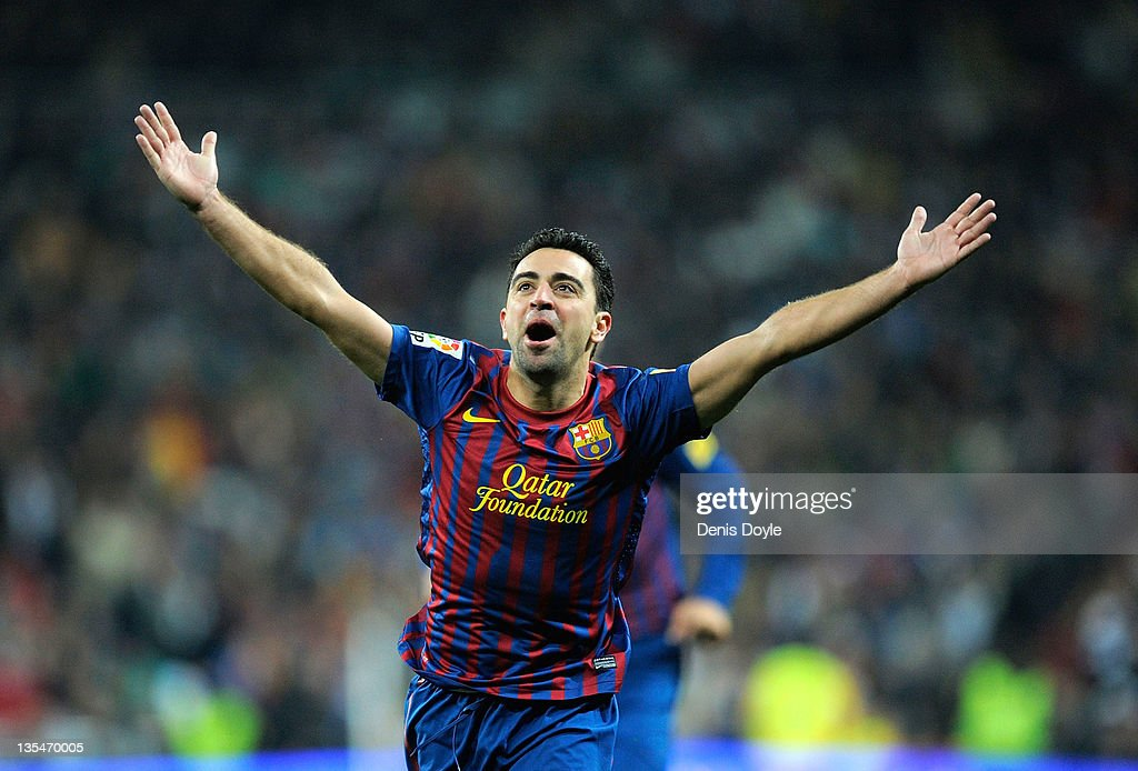 <a gi-track='captionPersonalityLinkClicked' href=/galleries/search?phrase=Xavi+Hernandez+-+Soccer+Player&family=editorial&specificpeople=2834438 ng-click='$event.stopPropagation()'>Xavi Hernandez</a> of Barcelona celebrate after Barcelona scoring Barcelona's 2nd goal during the La Liga match between Real Madrid and Barcelona at Estadio Santiago Bernabeu on December 10, 2011 in Madrid, Spain.