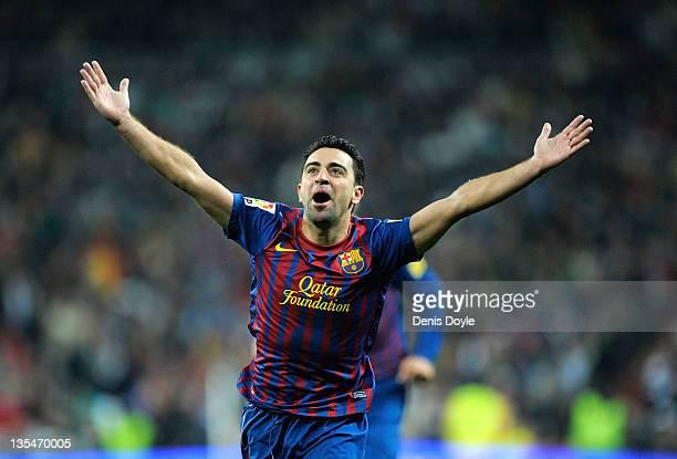 Xavi Hernandez of Barcelona celebrate after Barcelona scoring Barcelona's 2nd goal during the La Liga match between Real Madrid and Barcelona at...