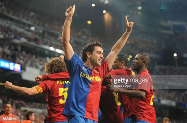 Xavi Hernandez of Barcelona celebrates after Gerard Pique scored Barcelona's sixth goal during the La Liga match between Real Madrid and Barcelona at...
