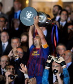 Xavi Hernandez of Barcelona celebrates with the Copa del Rey trophy after Barcelona beat Athletic Bilbao 30 during the Copa del Rey Final at Vicente...