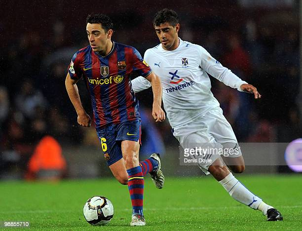 Xavi Hernandez of Barcelona is persued by Roman Martinez of Tenerife during the La Liga match between Barcelona and Tenerife at Camp Nou stadium on...