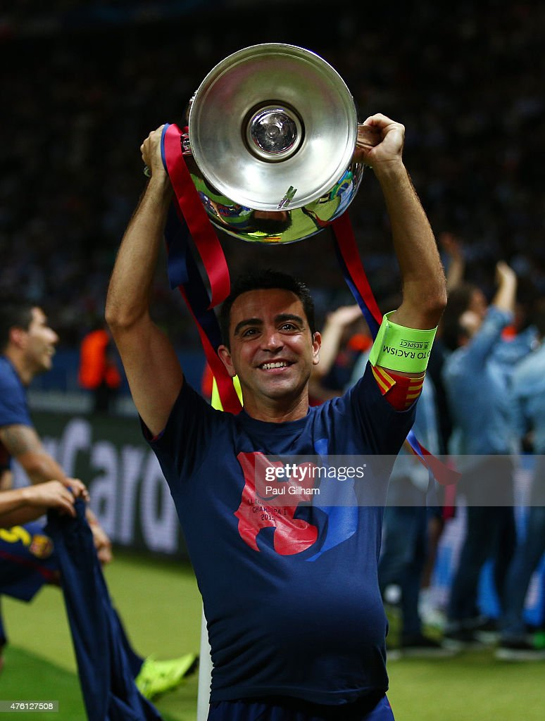 Xavi Hernandez of Barcelona lifts the trophy as he celebrates victory after the UEFA Champions League Final between Juventus and FC Barcelona at Olympiastadion on June 6, 2015 in Berlin, Germany.
