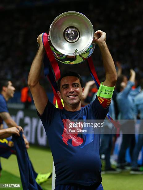 Xavi Hernandez of Barcelona lifts the trophy as he celebrates victory after the UEFA Champions League Final between Juventus and FC Barcelona at...
