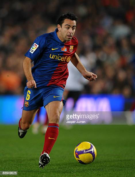 Xavi Hernandez of Barcelona runs with the ball during the La Liga match between Barcelona and Valencia at the Camp Nou Stadium on December 6 2008 in...