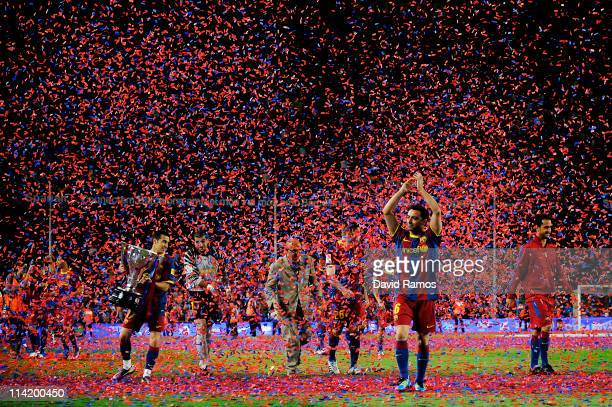 Xavi Hernandez of FC Barcelona aknowledges spectators during the celebrations for winning La Liga after the La Liga match between Barcelona and...