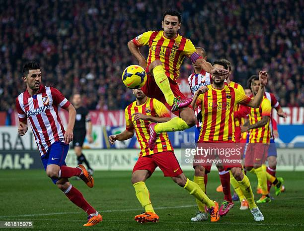 Xavi Hernandez of FC Barcelona controls the ball during the La Liga match between Club Atletico de Madrid and FC Barcelona at Vicente Calderon...