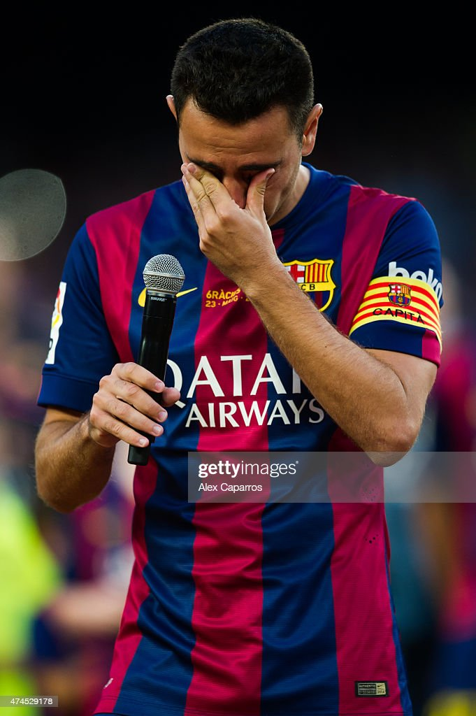 Xavi Hernandez of FC Barcelona cries as he speaks to the spectators after the La Liga match between FC Barcelona and RC Deportivo La Coruna at Camp Nou on May 23, 2015 in Barcelona, Spain.