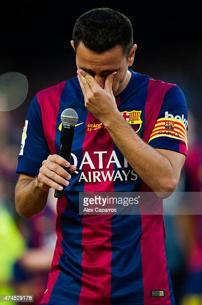 Xavi Hernandez of FC Barcelona cries as he speaks to the spectators after the La Liga match between FC Barcelona and RC Deportivo La Coruna at Camp...
