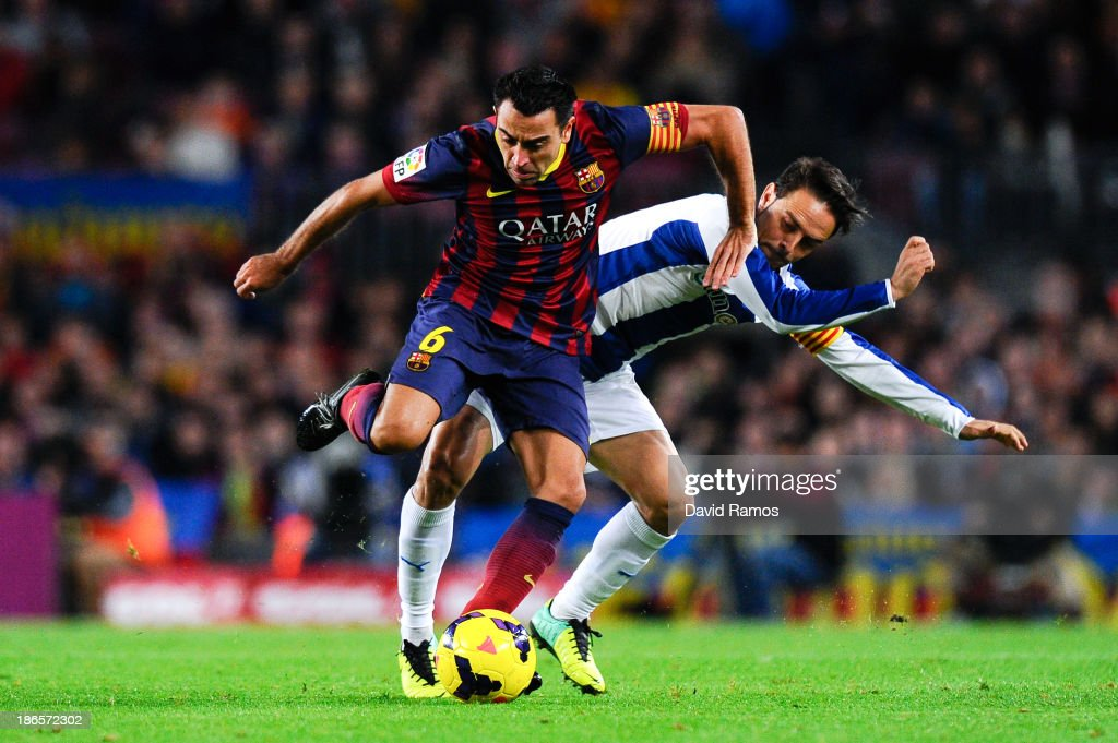 <a gi-track='captionPersonalityLinkClicked' href=/galleries/search?phrase=Xavi+Hernandez+-+Soccer+Player&family=editorial&specificpeople=2834438 ng-click='$event.stopPropagation()'>Xavi Hernandez</a> of FC Barcelona duels for the ball with <a gi-track='captionPersonalityLinkClicked' href=/galleries/search?phrase=Sergio+Garcia+-+Soccer+Player&family=editorial&specificpeople=5378767 ng-click='$event.stopPropagation()'>Sergio Garcia</a> of RCD Espanyol during the La Liga match between FC Barcelona and RCD Espanyol at Camp Nou on November 1, 2013 in Barcelona, Spain.