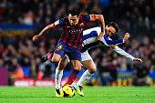 Xavi Hernandez of FC Barcelona duels for the ball with Sergio Garcia of RCD Espanyol during the La Liga match between FC Barcelona and RCD Espanyol...