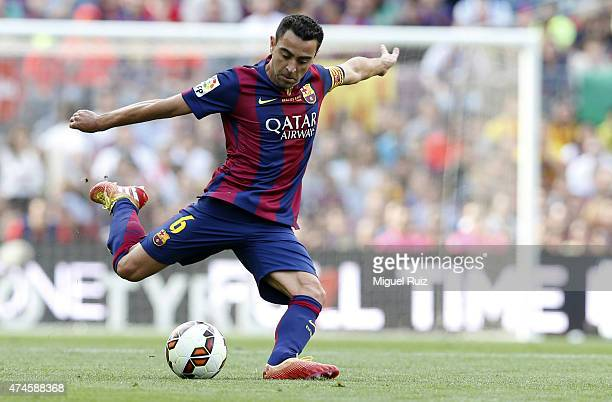 Xavi Hernandez of FC Barcelona kicks the ball during the La Liga match between FC Barcelona and RC Deportivo La Coruña at Camp Nou on May 23 2015 in...
