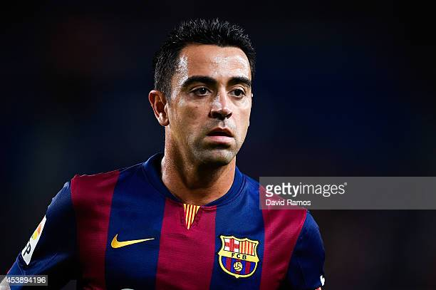 Xavi Hernandez of FC Barcelona looks on during the Joan Gamper Trophy match between FC Barcelona and Club Leon at Camp Nou on August 18 2014 in...
