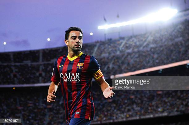 Xavi Hernandez of FC Barcelona looks on during the La Liga match between FC Barcelona and Sevilla FC at Camp Nou on September 14 2013 in Barcelona...