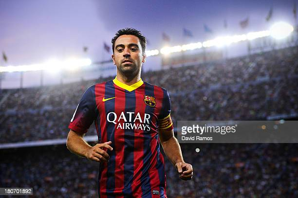 Xavi Hernandez of FC Barcelona looks on during the La Liga match between FC Barcelona and Sevilla FC at Camp Nou on September 14 2013 in Barcelona...