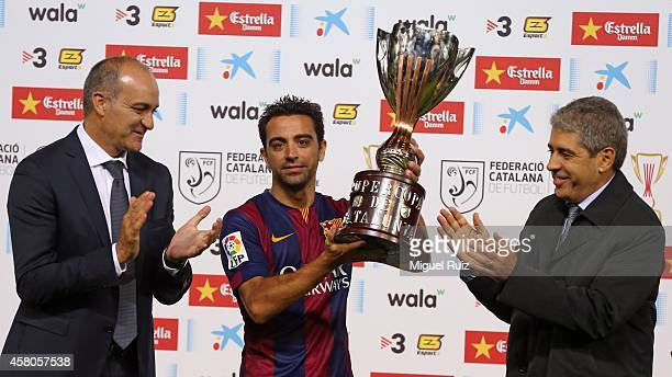 Xavi Hernandez of FC Barcelona poses with the trophy after winning the Catalunya Supercup Final at Montilivi Stadium on October 29 2014 in Girona...