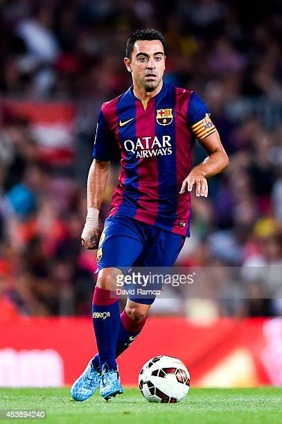 Xavi Hernandez of FC Barcelona runs with the ball during the Joan Gamper Trophy match between FC Barcelona and Club Leon at Camp Nou on August 18...