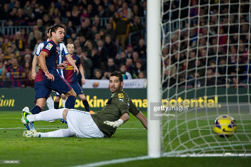 <a gi-track='captionPersonalityLinkClicked' href=/galleries/search?phrase=Xavi+Hernandez+-+Fotbollsspelare&family=editorial&specificpeople=2834438 ng-click='$event.stopPropagation()'>Xavi Hernandez</a> of FC Barcelona scores the opening goal during the La Liga match between FC Barcelona and RCD Espanyol at Camp Nou on January 6, 2013 in Barcelona, Spain.